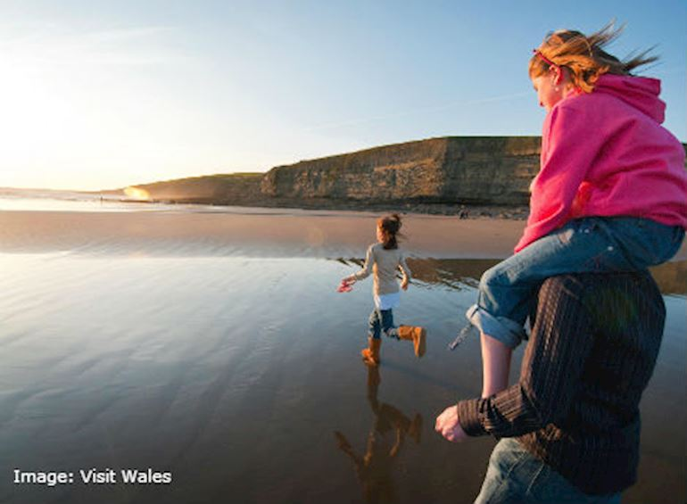 Family enjoying the beach. Image source: Visit Wales