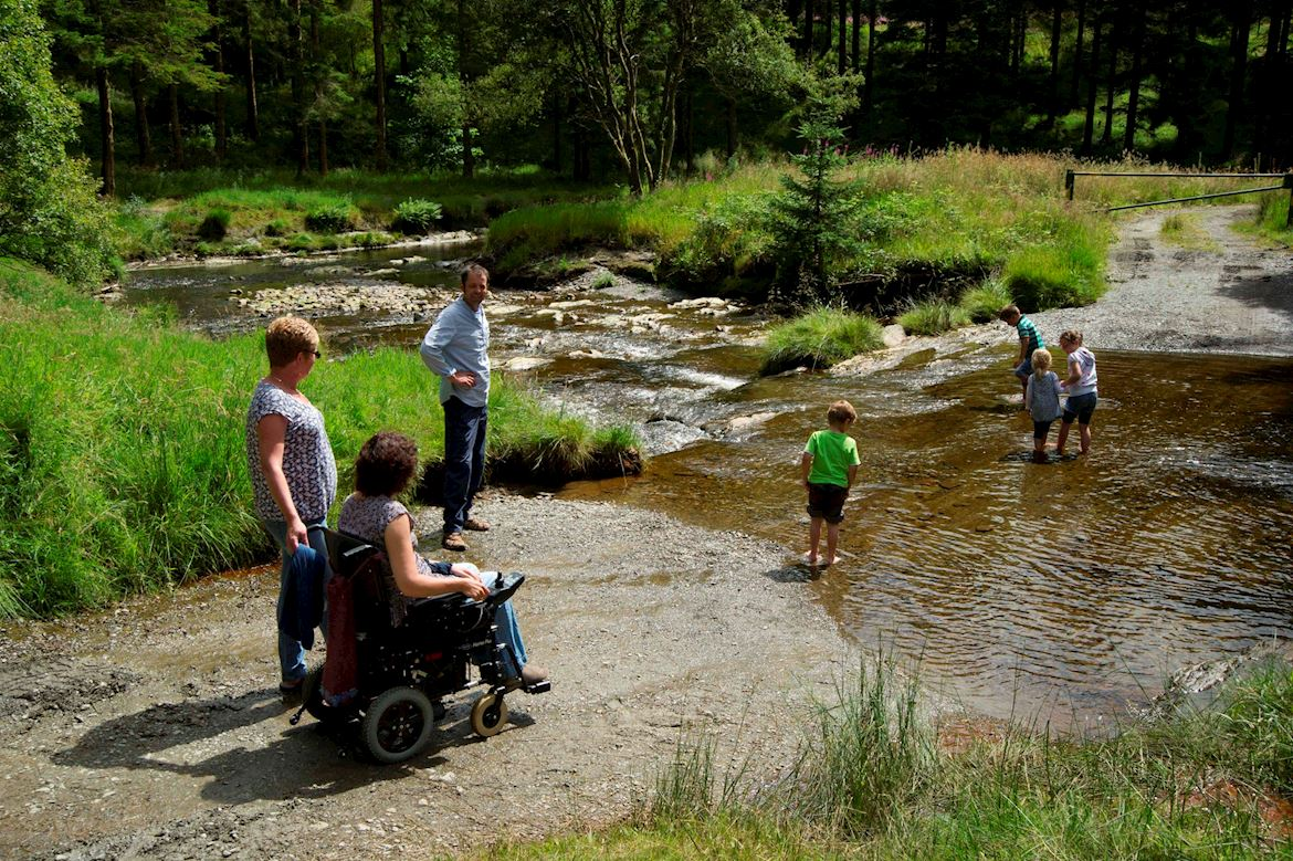 Family by stream in Hafren Forest