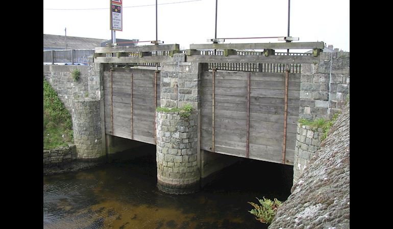 Penstocks on a bridge on the A497 road