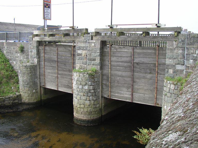 Penstocks on a bridge on the A497 road
