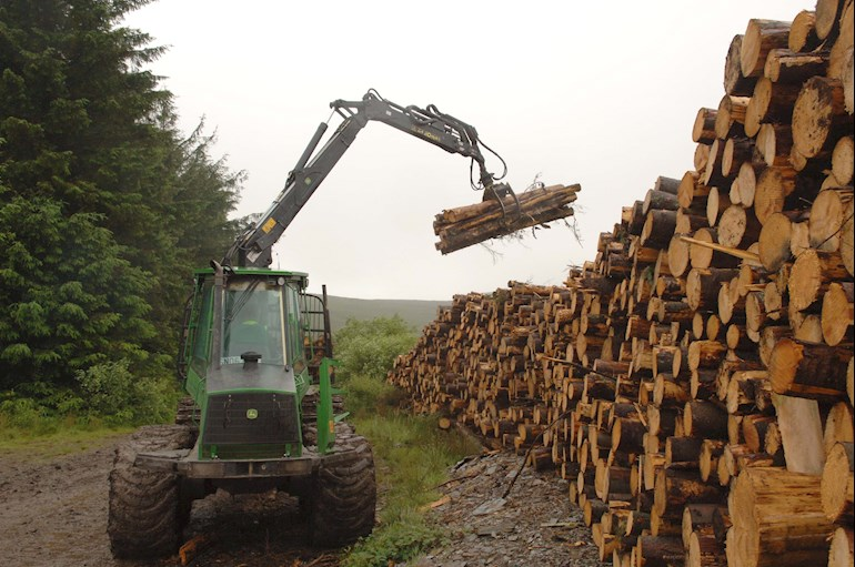 Tractor stacking timber