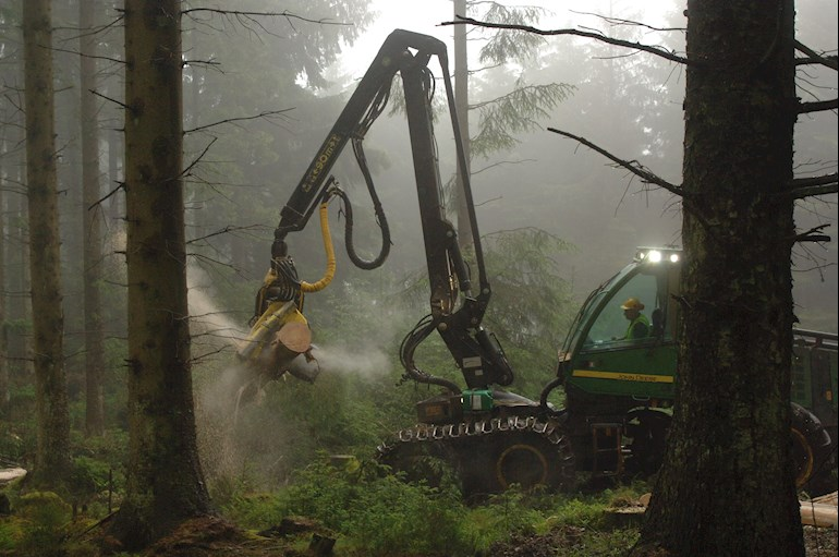 Tractor felling trees