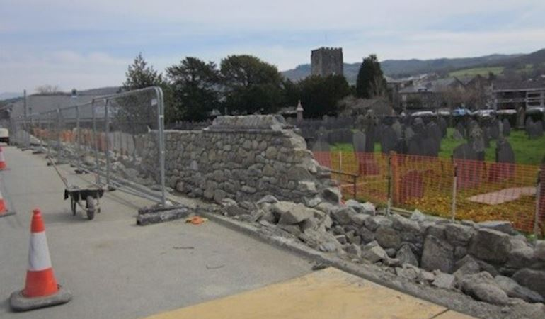 Repairing the stone wall in Dolgellau to improve the flood defences