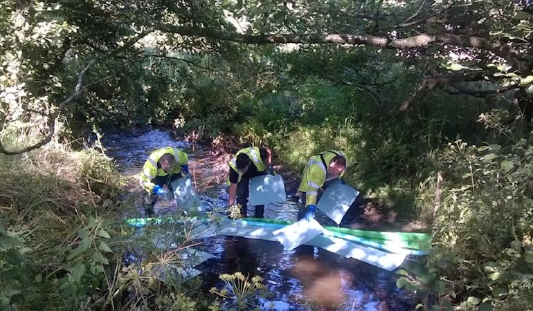 South ops team cleaning pollution from a river