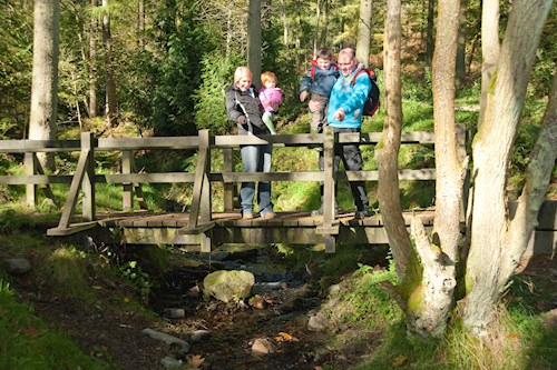 Family on a bridge at Coed Moel Famua car park