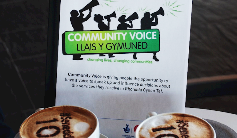 Community voice programme in front of two cups of coffee