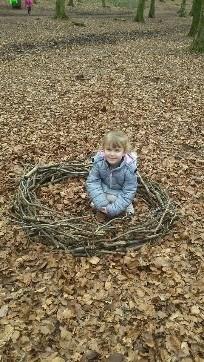 Girl building a nest
