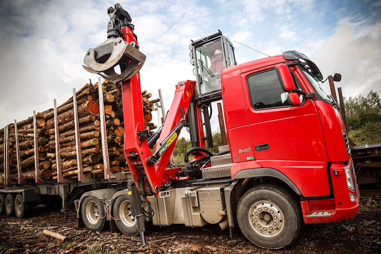 Red truck with timber