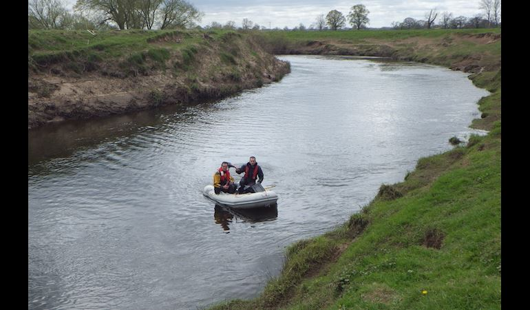 NRW officers investigating the pollution in the River Dee