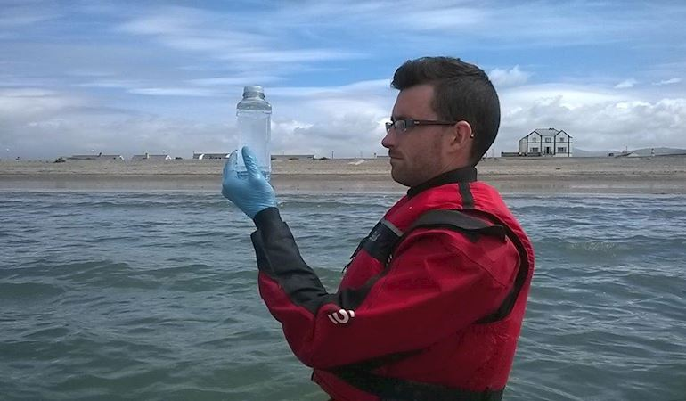 Rob Owen sampling bathing waters at Dinas Dinlle