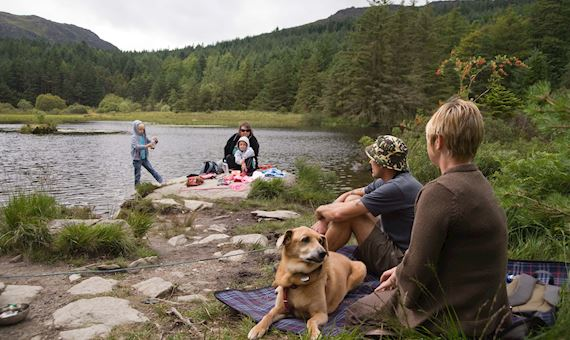 Family enjoying the lakeside at Beddgelert Forest