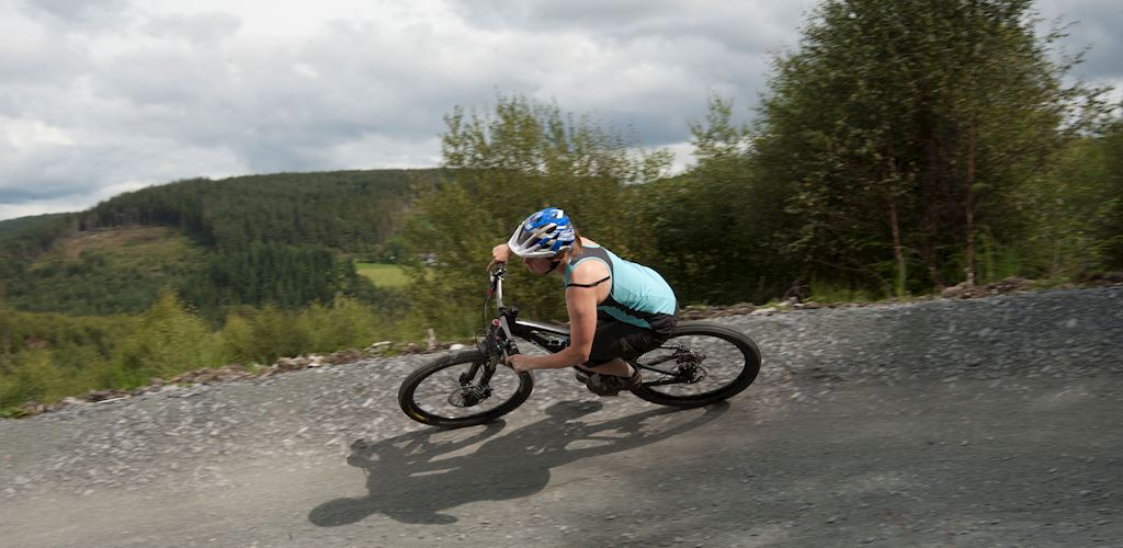 woman riding her bike on a mountain bike trail