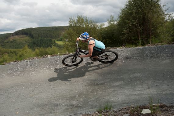 woman riding her bike on a mountain bike trail