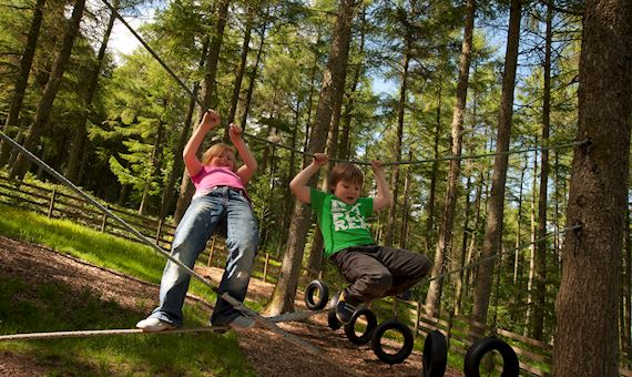 Two children playing at Garwnant Visitor Centre