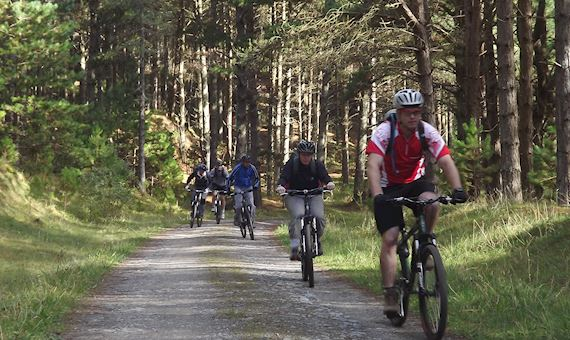 People cycling through Newborough