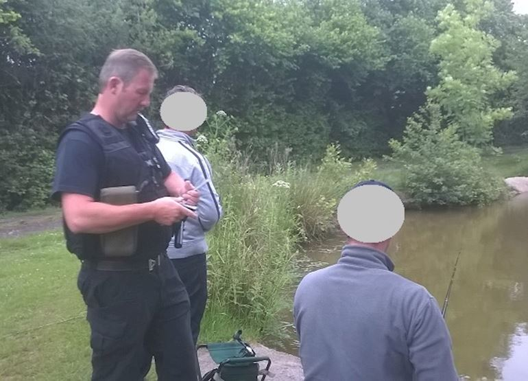 NRW enforcement officer checking rod licences