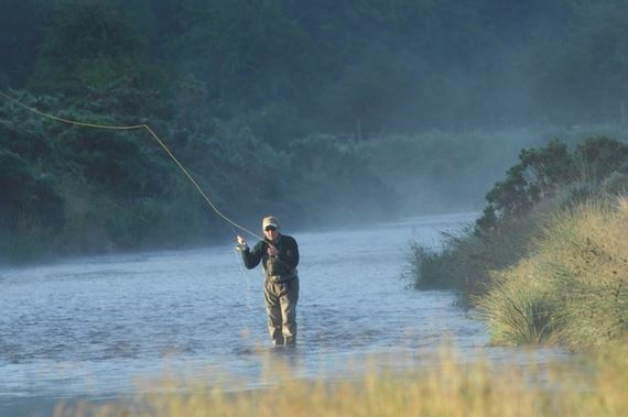 Man fly-fishing in a river