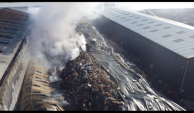 Aerial view of Lancashire Fuels 4 U while on fire