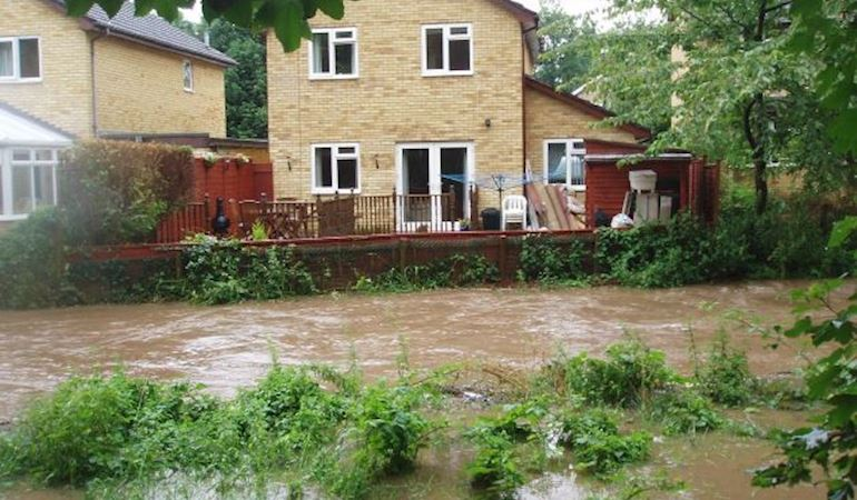 River burst its bank behind properties in Dinas Powys, 2007