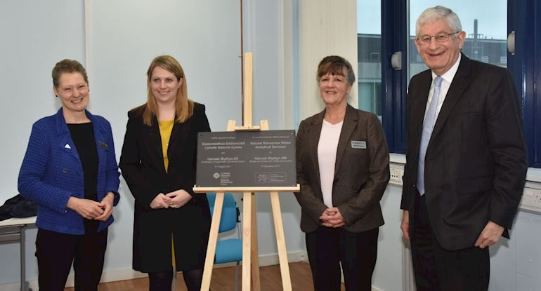 Photo of Dr Madeleine Havard, Hannah Blythyn, Dr Elizabeth Haywood and Prof Richard Davies around the opening plaque