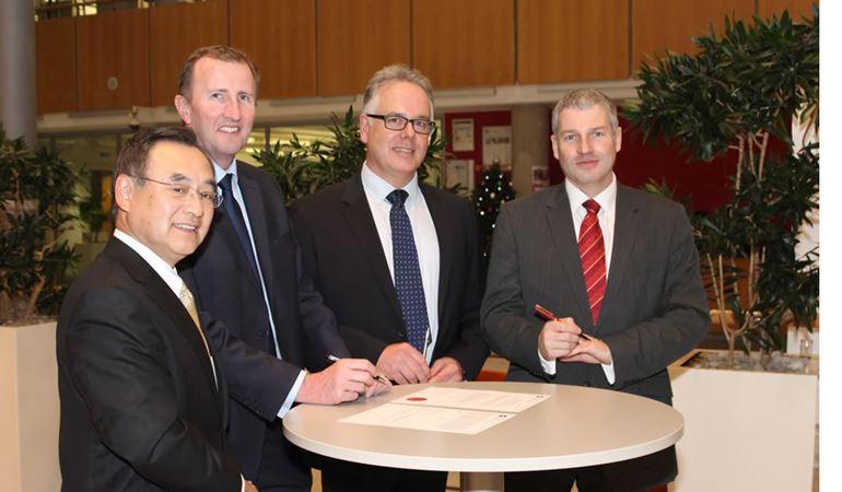 Image of Tim Jones (NRW), Mark Foy (ONR) and Dr Jo Nettleton (EA) approving the new nuclear power station design