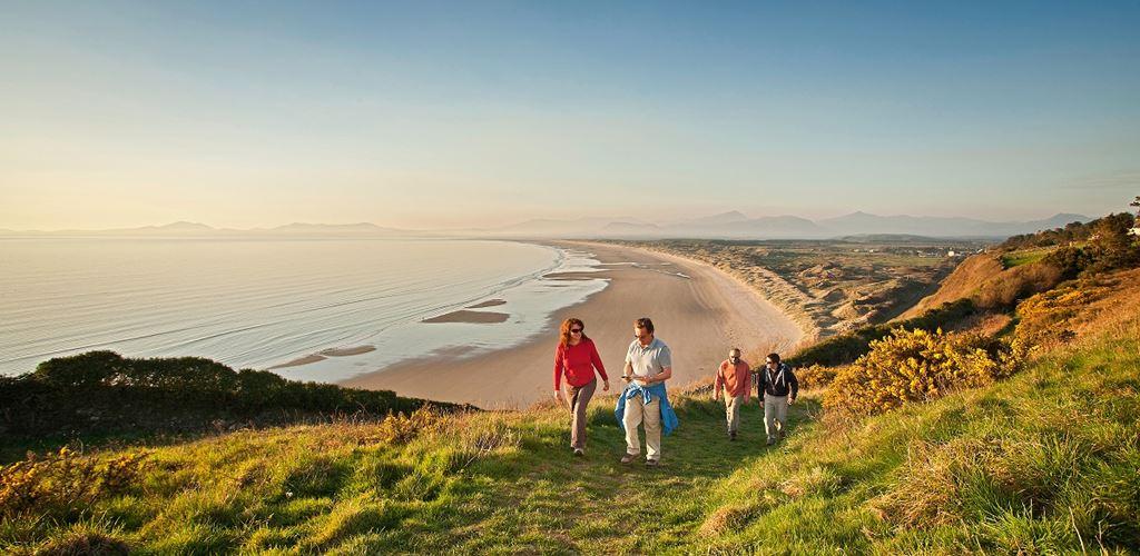 Walkers near a beach