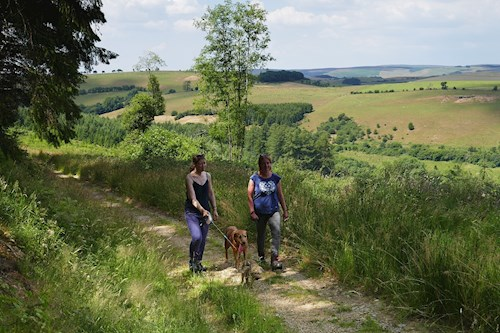 Two women with dog on Fishpools Trail