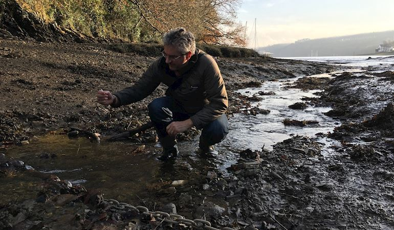 A man collecting a water sample