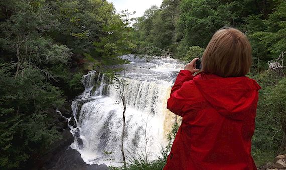Woman looking at a waterfall