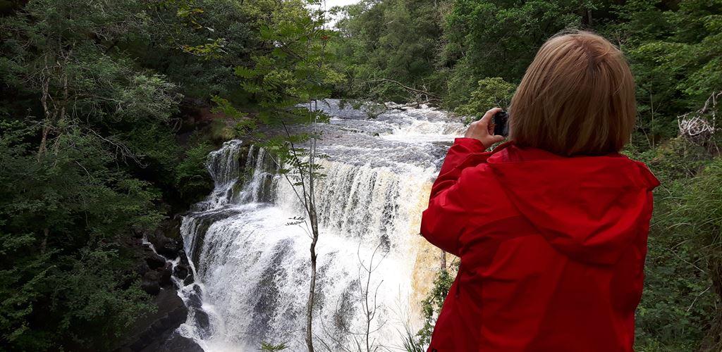 Woman looking at a waterfall