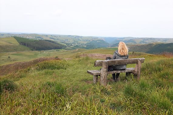Woman on bench looking at view