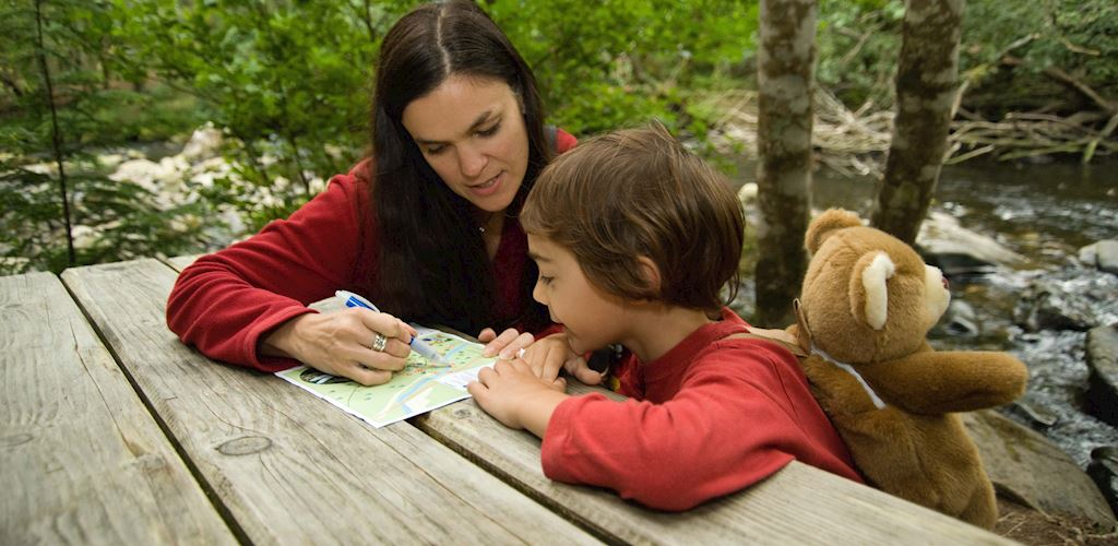 Mother and child looking at leaflet