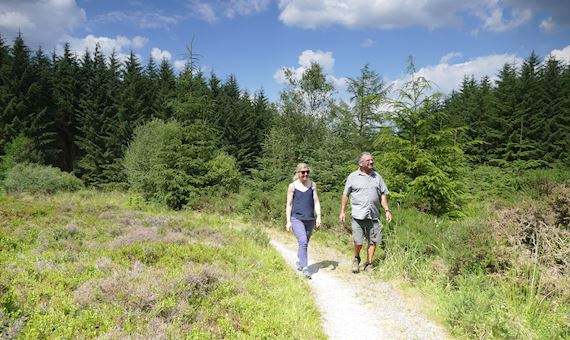Man and woman walking on Fishpools Walk