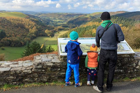 Man and children at viewpoint