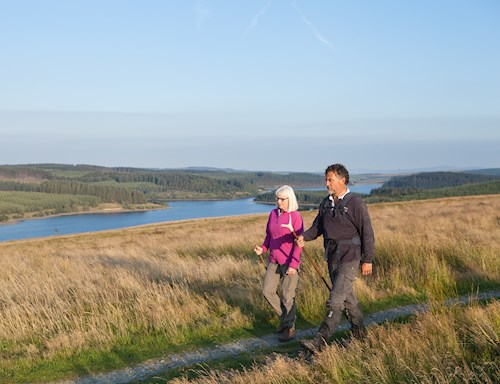 Man and woman walking on Alwen Trail