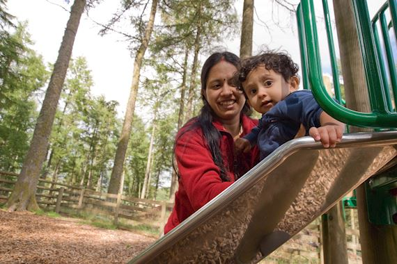 Woman and child in play area