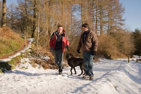 Men walking in snow
