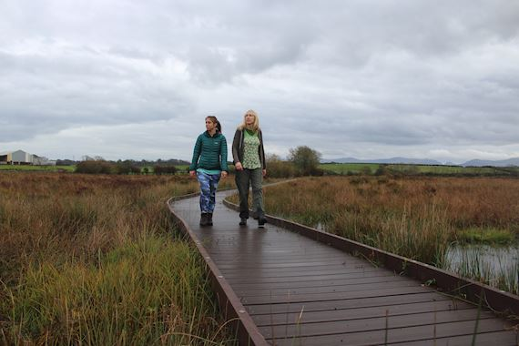 Two women on boardwalk