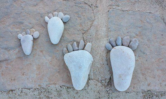 Feet made of stones design on a beach