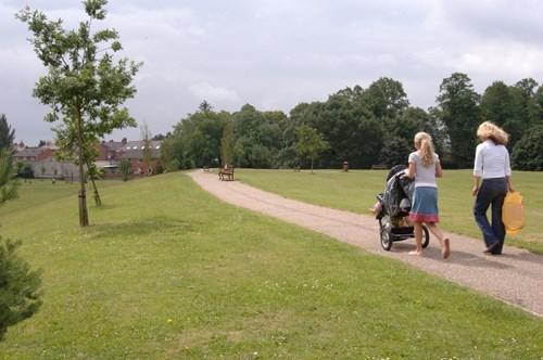 People walking town park in Wrexham