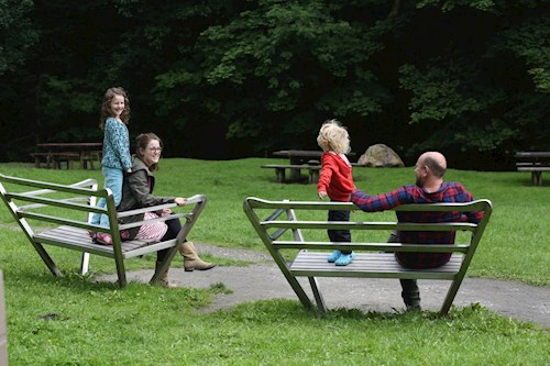Family on park benches in Clywedog Valley