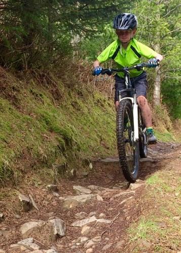 Boy riding on trail