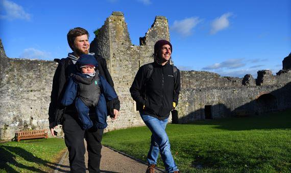 Family walking in Chepstow castle