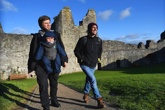 Family walking in Chepstow castle