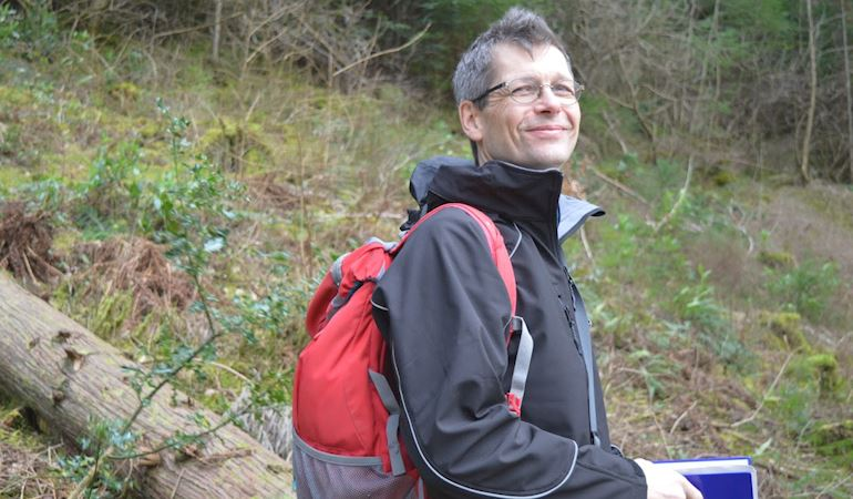 Forest planner Mike Indeka in the woods